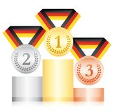 Gold silver and bronze medals on a podium. Award ceremony sport icon. Black red and yellow ribbon. German ribbon flag. Gold silver and bronze medals on a podium Royalty Free Stock Photography