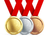 Gold, silver and bronze medals with red ribbons  on white background Royalty Free Stock Photography