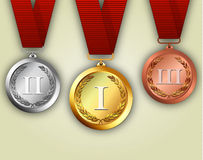 Gold silver and bronze medals on ribbons Stock Photography