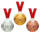 Gold, silver and bronze medals Stock Image