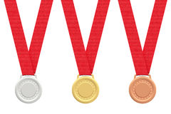 Gold, silver and bronze medals on white Royalty Free Stock Photo