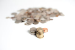 Gold, silver, and bronze piles of coins Stock Photos