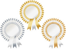 Gold, silver, bronze rosettes. Rosettes in gold, silver and bronze to represent first, second and third Royalty Free Stock Photo
