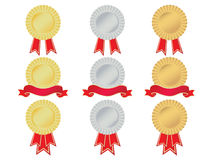 Gold silver and bronze rosettes. Set of gold, silver and bronze rosettes, with banners and ribbons. No gradient meshes used, so very easy to edit Stock Images