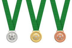 Gold, silver and bronze soccer medals stock image
