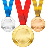 Gold, silver, bronze sport medals with ribbon Royalty Free Stock Photography
