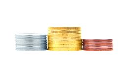 Gold, silver and bronze stacks of coins Royalty Free Stock Photography