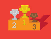 Gold, Silver and Bronze Trophy Cup on prize podium Stock Photo