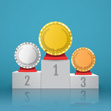 Gold, Silver and Bronze Trophy Cup on prize podium. Royalty Free Stock Photo