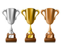 Gold, silver and bronze trophy set Stock Photography