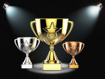 Gold, silver and bronze trophy on stage. 3d rendering gold, silver and bronze trophy on stage with shining lights royalty free stock photo