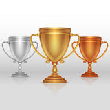 Gold, silver and bronze winners cup, goblet vector set. Gold, silver and bronze winners cup, goblet vector. Set of sports trophies to the winners illustration Stock Photography