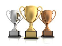 Gold, silver and bronze winners cup Stock Photography