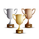 Gold, silver and bronze winners cup. Vector set of trophy cups. Gold, silver and bronze winners cup isolated on a white background Stock Photos