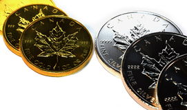 Precious Metals Money Gold Silver Maple Leaf Bullion Coins - Investment Finance Illustration Isolated. Two rows of Gold and Silver bullion coins, one-ounce Maple Royalty Free Stock Images