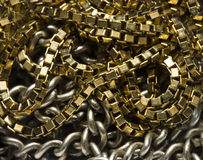 Gold and silver chain. Extreme close-up of gold and silver chain royalty free stock images