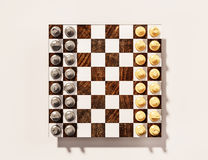 Gold and Silver chess game on wooden chess board, 3d rendered Royalty Free Stock Photography