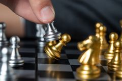 Gold and silver chess with player royalty free stock images