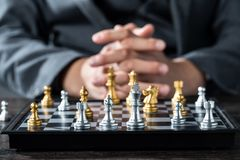 Gold and silver chess with player royalty free stock photography