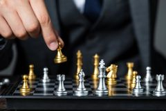 Gold and silver chess with player stock images
