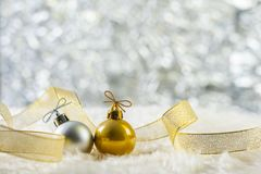 Christmas ball on wool. Gold and silver Christmas ball on wool, twinkle bokeh background royalty free stock photography