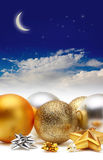 Gold and silver Christmas balls. Under sky royalty free stock images