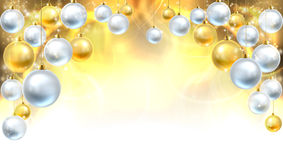 Gold and Silver Christmas Baubles Background Royalty Free Stock Images