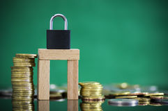 Gold and silver coin stacked  with padlock and key. Stock Images