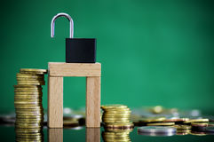 Gold and silver coin stacked  with padlock and key. Royalty Free Stock Photos