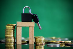 Gold and silver coin stacked  with padlock and key. Stock Image