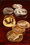 Gold and silver coins Stock Photo