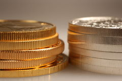 Gold and silver coins Stock Photography