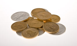 Gold and Silver Coins. One Ounce gold Krugerrand coins from South Africa and One Royalty Free Stock Photo