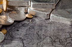Gold & Silver Coins & Bars on Map over Europe, Asia, Africa.  royalty free stock images