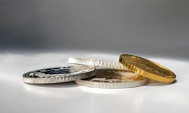 Gold and silver coins in close-up on a grey background Stock Photos