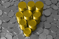 Gold and silver coins Stock Images