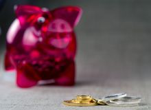Gold and silver coins and red piggy bank. stock photography