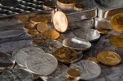 Gold & Silver Coins with Silver Bars on map.  stock photos