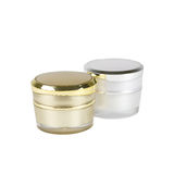 Gold and silver container of cream Stock Photography