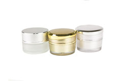 Gold and silver container of cream Royalty Free Stock Photography