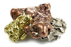 Gold, silver and copper nuggets. Native gold, silver and copper nuggets isolated on white background royalty free stock photo