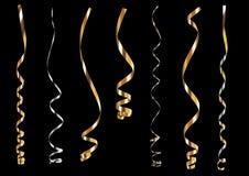 Gold and silver curling ribbons set. Precious gold and silver curling ribbons or party serpentine set Stock Photo