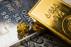 Gold, silver and dollar bill Stock Images