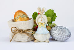 Gold and silver Easter egg with wooden bunny Royalty Free Stock Images