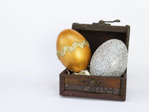 Gold and silver Easter egg in wooden vintage box stock photos