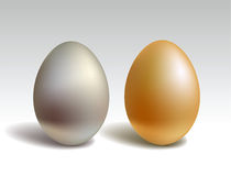 Gold and silver eggs Stock Image