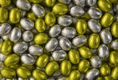 Gold and Silver eggs. Background from gold and silver chocolate Easter eggs stock photo