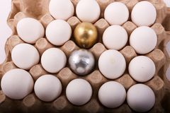 Gold and silver eggs Royalty Free Stock Photo