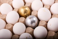 Gold and silver eggs Stock Photos