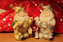 Gold and silver figures of Santa Claus Stock Photos